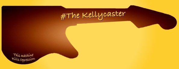 "Silhouette of The Kellycaster body shape with The Kellycaster logo on neck and inscription ""This Machine Kills Oppression"" on body of guitar.."